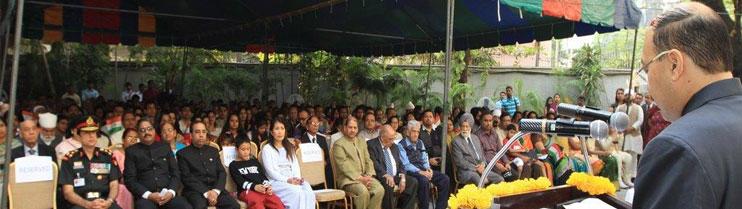 Ambassador Harsh Vardhan Shringla reading out the President's address after unfurling the national flag